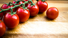 Red juicy tomatoes on a cutting board Royalty Free Stock Images