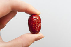 Red jujube. A red jujube  in hand Stock Photography