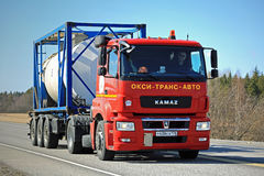 Red Kamaz Truck T1840 Tank Container Transport on Sunny Day Royalty Free Stock Images