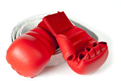 Red karate gloves with belt Stock Images