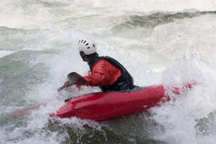 Red kayak in action Royalty Free Stock Photos