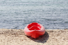 Red kayak in the beach Stock Photos