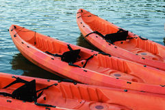 Red kayak on dark river water.  Stock Images