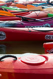 Red kayak, rose kayak, green kayak. Royalty Free Stock Image