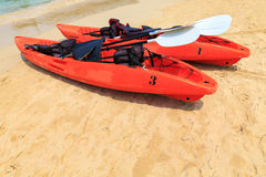 Red kayak on sea beach Stock Photography