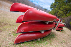 Red kayaks. Stacked up along the river royalty free stock image