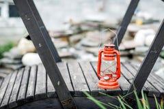 Red kerosene lamp isolated on garden background Stock Images