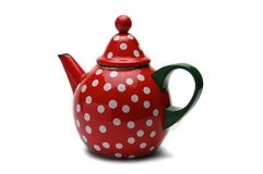 Red kettle for brewing tea.Teapot.Isolated on white background. Red teapot with white peas for brewing tea.Kettle.Isolated on white background royalty free stock photography