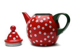 Red kettle for brewing tea.Teapot.Isolated on white background. Red teapot with white peas for brewing tea.Kettle.Isolated on white background royalty free stock image