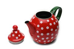 Red kettle for brewing tea.Teapot.Isolated on white background. Red teapot with white peas for brewing tea.Kettle.Isolated on white background stock image