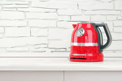 Red kettle in table kitchen room interior Stock Photography