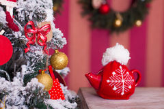 Red kettle with tea from a Christmas tree on an old table Royalty Free Stock Image