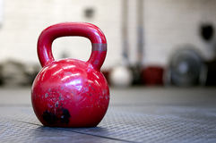 Red Kettlebell on a gym floor Stock Photo