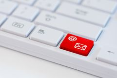 A red key with mail icon symbol on white laptop keyboard Stock Photography