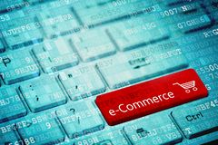 Red key with text e-Commerce and padlock icon on blue digital laptop keyboard.  stock photography