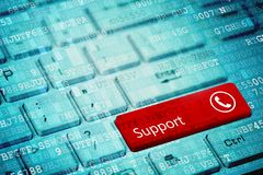 Red key with text Support and phone icon on blue digital laptop keyboard stock images