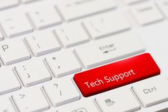 Red key with text tech support on white laptop keyboard Royalty Free Stock Photos