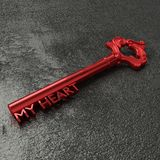 Red key to my heart on a black stone table. Red vintage key with the words my heart on a rough black stone table 3D illustration Stock Photo