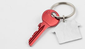 Red Key to the new house. The key to your own new house Royalty Free Stock Image