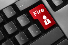 Red keyboard button fire employee  dismissal Stock Photo