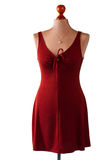 Red keyhole dress and pendant. Royalty Free Stock Photography