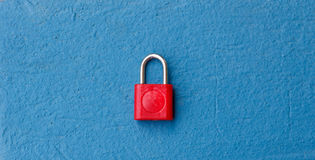 Red Keypad Lock. The Red Keypad on Blue Wall Stock Image