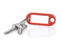 Red keyring. Two keys on a blank keyring with space for text, isolated on white Stock Photo