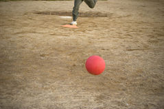 Red kickball approach Stock Image