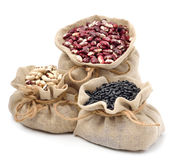 Red kidney beans, black beans and black-eyed beans in the sacks Royalty Free Stock Image