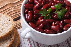 Red kidney beans in a bowl and bread horizontal top view Royalty Free Stock Photography