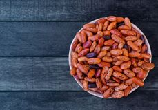 Red Kidney Beans in Bowl Lay on Wooden Table. In Kitchen, Preparing Raw Food for Cooking Stock Photography