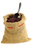 Red kidney beans in a burlap bag. And an aluminum scoop on a white background Stock Photography