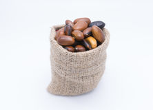 Red kidney beans in gunny bag isolate on white Royalty Free Stock Photography