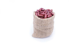 Red kidney beans in gunny bag isolate on white. Background Stock Images