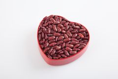Red kidney beans in heart shape box Stock Image
