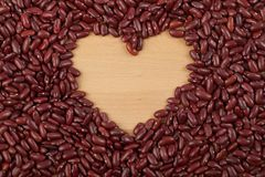 Red kidney beans with heart shape Royalty Free Stock Photos