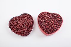 Red kidney beans in two heart shape boxes Royalty Free Stock Photos