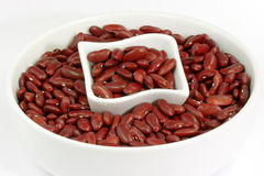 Red Kidney Beans in a white bowl. On bright background stock photos