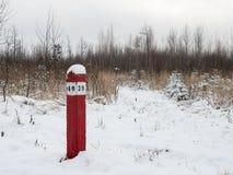 Red kilometer column, village road royalty free stock photos