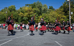 Red Kilts. Bethlehem, PA, USA-September 28, 2014: Pipe band marching in the Celtic Classic. The Classic is one of the largest Highland Games and Festival in royalty free stock photos