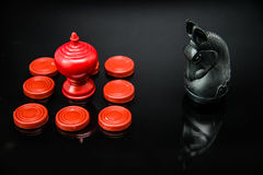 Red King chess in group of pawns challenge with Black Knight Thai chess piece on black background and selective focus. 1 Stock Image