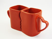 Red kissing cups Royalty Free Stock Photos
