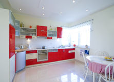 Red kitchen. Elegant kitchen in a modern house, red furniture Stock Image
