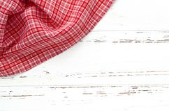 Red kitchen cloth on white vintage wooden table. copy space.  Stock Photography