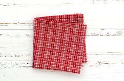 Red kitchen cloth on white vintage wooden table. copy space stock photo