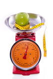 Red kitchen scale with an apple stock images