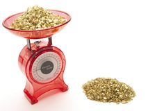 Red kitchen scales with a pile of gold Stock Photography