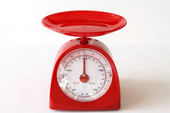Red kitchen scales. Royalty Free Stock Photography