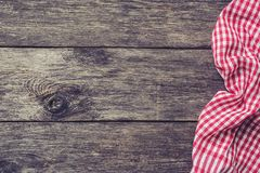 Red kitchen textile on rustic wood. Picnic summer background. Top view with copy space for text Royalty Free Stock Image