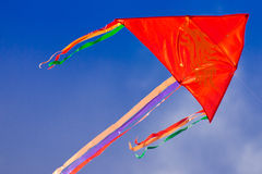 Red kite, blue sky, copy space Royalty Free Stock Image